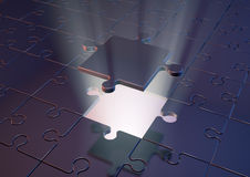 Solving jigsaw puzzle Stock Photography