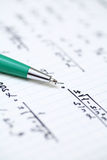Solving Mathematical Problem. Equations close-up. Homework. Solving Mathematical Problem. Focus on pen. Shallow depth of field Stock Images