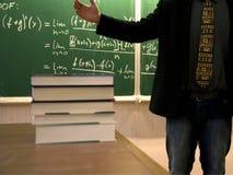 Solving a problem. Solving a math problem at a blackboard Stock Photo