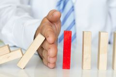 Solving problem and domino effect abstract business concept Royalty Free Stock Images