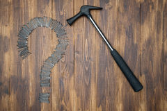 Solving  problem, nail on Question Mark with hammer Stock Photo