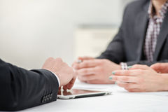 Solving problems! Hands of three and two businessmen discussing Royalty Free Stock Photos