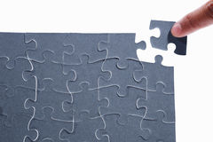 Solving the puzzle Stock Photo