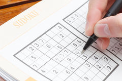 Solving sudoku stock photo