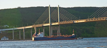 Solway Fisher under Kessock Bridge with pilot boat. Solway Fisher leaving the Port of Inverness with pilot boat under Kessock Bridge Stock Images