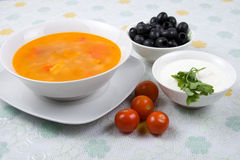 Solyanka. Russian traditional spicy soup of vegetables and meat with olives Royalty Free Stock Photos