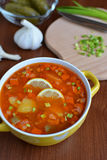 Solyanka mix soup with sausages, potatoes and lemon. Delicious  Solyanka mix soup with sausages, potatoes and lemon Royalty Free Stock Images