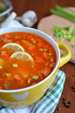 Solyanka mix soup with sausages, potatoes and lemon. Delicious  Solyanka mix soup with sausages, potatoes and lemon Stock Photos