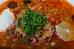 Solyanka mix soup. With sausages, olives and lemon Stock Images