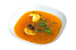 Solyanka - Orange Soup with meat, sausage and lemon and olive isolated on white Royalty Free Stock Photography