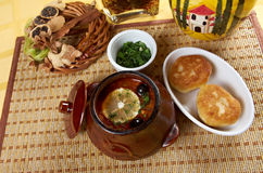 Solyanka on the plate. Solyanka, Russian soup with beef,sausage,chicken and lemon, olives stock photos