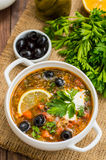 Solyanka, Russian dishes, soup on a steep meat broth with hot spices. Wooden background. Top view. Close-up Stock Image