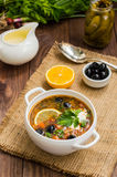 Solyanka, Russian dishes, soup on a steep meat broth with hot spices. Wooden background. Top view. Close-up stock photo
