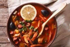 Solyanka - Russian meat soup in bowl closeup horizontal top view. Solyanka - Russian traditional meat soup in bowl close up horizontal top view Stock Photos