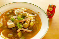 Solyanka - Russian soup. Solyanka is a traditional, spicy and sour soup in the Russian and Ukrainian cuisine Stock Image