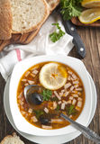Solyanka, Russian soup with meat, sausage, olives and pickles Stock Photos