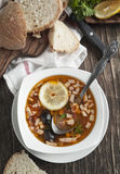 Solyanka, Russian soup with meat, sausage, olives and pickles. Served in plate Stock Images