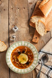 Solyanka, Russian soup with meat, sausage, olives and pickles Royalty Free Stock Photos
