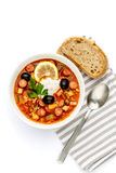 Solyanka - Russian traditional meat soup. On white background Stock Photos