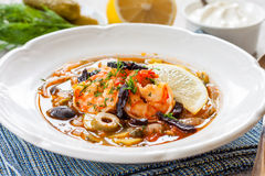 Solyanka with seafood. Sour soup with prawns and pickled cucumbers. Russian kitchen royalty free stock photos