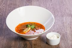 Solyanka soup with lemon. And cream royalty free stock photos