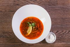 Solyanka soup with lemon. And cream stock images