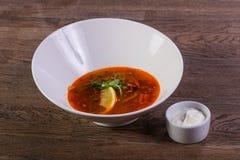 Solyanka soup with lemon. And cream Stock Photos