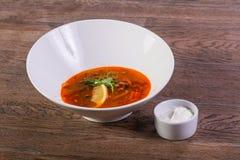 Solyanka soup with lemon. And cream Stock Image