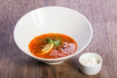 Solyanka soup with lemon. And cream royalty free stock photo
