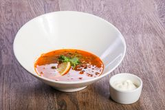 Solyanka soup with lemon. And cream stock image