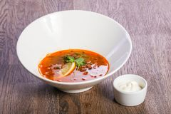 Solyanka soup with lemon. And cream stock photography