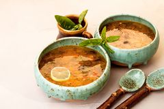 Solyanka soup with meat, smoked meat, sausages, pickled cucumber Stock Photos