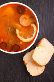 Solyanka soup with sausages olives Stock Photos