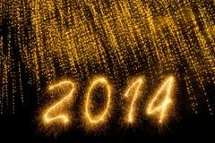 2014 som är skriftlig i guld- brusandebokstäver arkivfoton