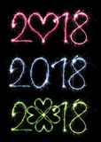 2018 som är skriftlig med tomtebloss på svart bakgrund Royaltyfri Foto