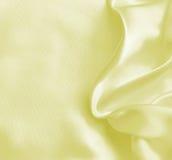 som bakgrund smooth eleganta guld- silk Arkivbilder