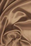 som bakgrund smooth eleganta guld- silk I tonad sepia retro Arkivfoto