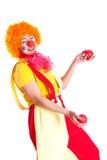 som clown klätt jonglera för flicka Fotografering för Bildbyråer