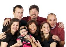 som familythreeutvecklingsutvecklingar som poserar tre Royaltyfri Foto