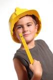 som gullig ungearbetare för konstruktion royaltyfria bilder