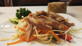 Som Tam or Papaya Salad with Grill Pork and Sticky Rice in Bamboo Container. In Background Royalty Free Stock Photo