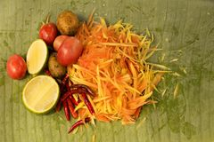 Som Tam papaya salad. Raw materials used to cook papaya salad or som tam on green banana leaf Stock Images
