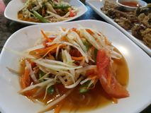 Som Tam is a popular local Thai food. Somtum is a popular local thai dish delicious on a white plate in a restaurant stock images