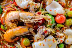 Som Tam Seafood Spicy Papaya Salad with salted crab, on wooden. Table Thai food stock photo