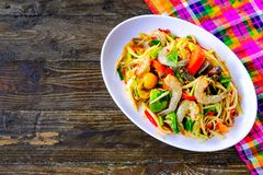 Som Tam Seafood Spicy Papaya Salad. With salted crab, on wooden table Thai food royalty free stock images