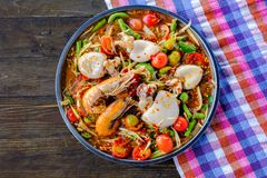 Som Tam Seafood Spicy Papaya Salad with shrimp with squid. On wooden table Thai food stock images