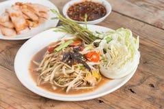 Som Tam is spicy green papaya salad. Stock Photo