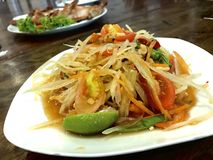 Som Tam or spicy papaya salad, Thai popular food that can be found everywhere in Thailand.  royalty free stock photography
