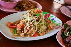 Som Tam Thai. Green papaya salad is a spicy salad made from shredded unripe papaya.Locally known in Thailand as som tam Royalty Free Stock Images