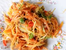Papaya salad. SOM-TAM Thai delicious raw papaya salad with unique taste hot and spicy stock photo